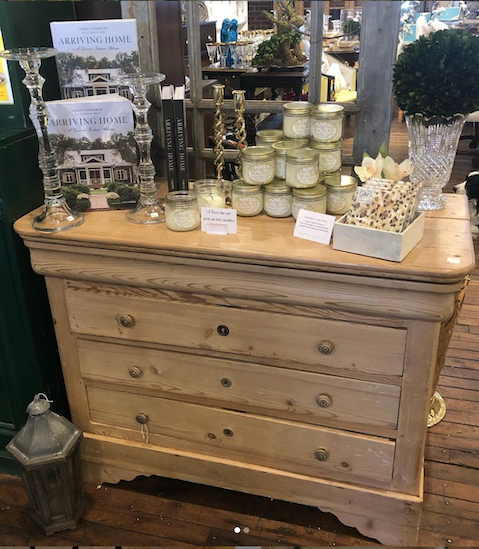 Antique pine chest, candles, coffee table books at Acquisitions Ltd Antique store in Raleigh, NC